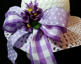 Pretty tea party, Easter, dress up, child's hat. White and purple with large bow. Dots and gingham ribbon with purple and yellow flowers.