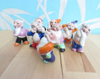 Eight vintage foreign quirky porcelain dwarf/gnome-type figurines