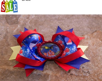 Nemo and Dory are feature in this beautiful hair bow, girls hairbow, kids hairbow, disney hair bow, girls hair bow