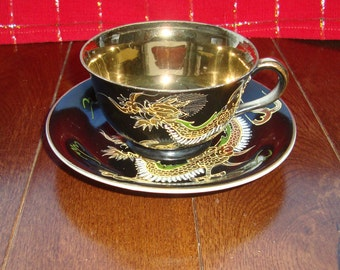 Occupied Japan Hand Painted Dimensional Dragons - Vintage Tea Cup and Saucer - Gold, Green and White Dragons on Black, Cup has Gold Interior