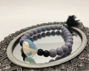 Dusty Lilac Gray & Matte Black Beaded flexible bracelet with a Heartshaped Opalite Glass Crystal and Jet Black Tassel.