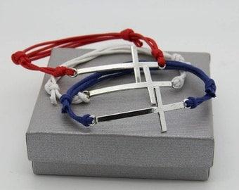 Cross and adjustable cord bracelet