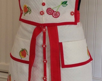 Vintage linens, women's full apron, red vintage button bodice, embroidered peach cherry, two vintage pockets
