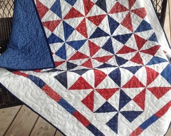 "Pinwheel baby quilt - blues and reds with blue backing 48"" x 56"""