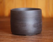 Dark brown unglazed pot in a chunky masculine style