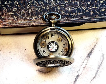 Steampunk pendant bronze colour pocket watchcase (diameter 48mm), real compass, dial, gears and resin with leather cord