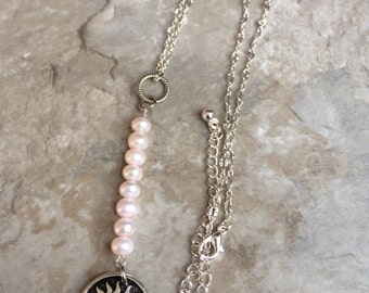 Silver sunburst and pearl necklace