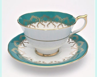 Vintage Aynsley, English Bone China Tea Cup & Saucer in White, Vivid Teal, and Gold, ca. 1939