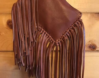 Custom made western leather clutch with nice interior and knotted fringe