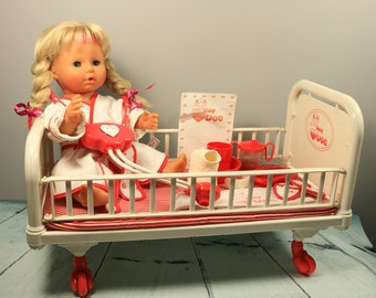 Vintage Zapf Baby Doc doll with hospital bed and accessories
