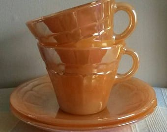 1960s vintage Termocrisa tea cup and saucer. Lustre wear/ Iridescent peach/orange