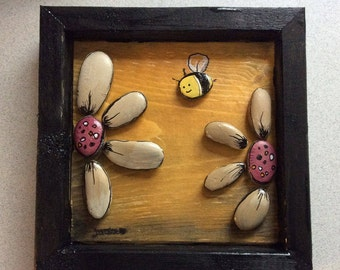 Stone art painted flowers and a bee