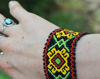 handmade vintage tribal native beaded bracelet /yellow, red, black, green seed bead bracelet