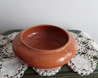 Vintage Ceramic Glazed Planter orange in color