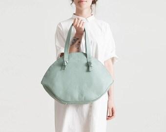 Eye-color pastel leather bag