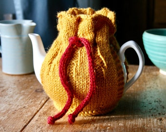 Gold tea cozy