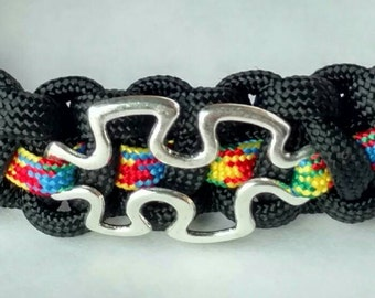 FREE US Shipping!! Paracord wristband with puzzle piece for Autism Awareness.  15% of profit to charity!