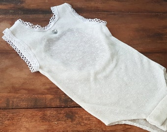 Gorgeous Knitted Bodysuit with Lace trim and Diamante Hearts.