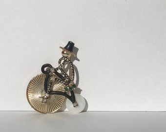 Caricature Brooch Pin of Man riding Penny-Farthing Bike