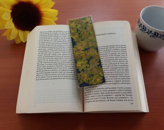Bookmark painted with acrylic front and rear sunflowers on blue background with yellow flowers that hold the sign of your favorite book gift ideas