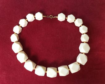 A Vintage Ivory Colour Graduated Beaded Necklace with Small Gold Separator Beads