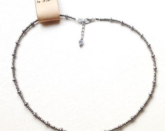 necklace by metallic beads with silver pendant with rhinestone