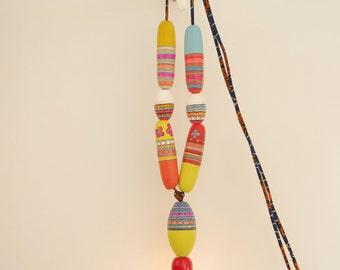 Lamp light necklace floats 2