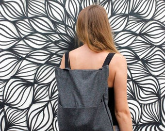 stylish backpacks made of stable felt with pockets on the outside