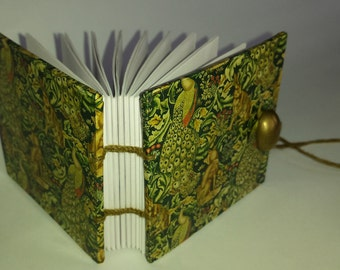 Small Coptic-bound decoupage notebook depicting Morris Forest design