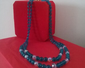Blue glass necklace long two files in the same colored swaroski alchool small AC.