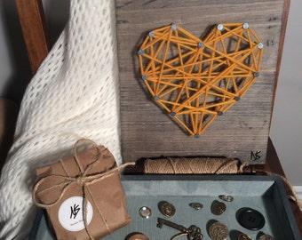 Heart in wool on wood