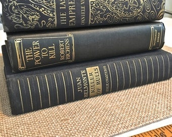 Set of Three Black with Gold Printed Books from the 1930's