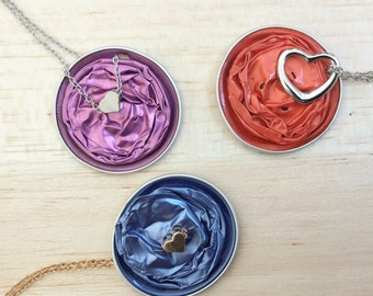 Nespresso capsule with heart charm necklace