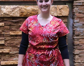 Womens Asymmetrical  Scrub Top in Reds and Golds