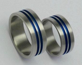 pair of anodized titanium engagement rings titanium weddingrings anodized flat titanium bands - Titanium Wedding Rings