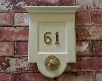 Cast stone doorbell/house number plaque