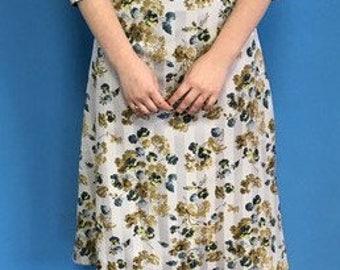 A-line flower dress with waist line, belt and a circular high neck line