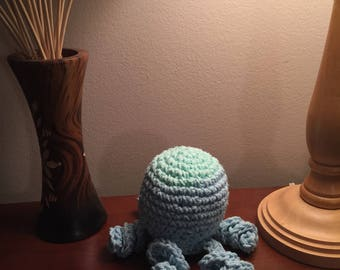 Crocheted blue and green octopus