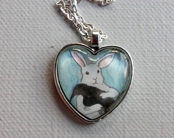 Bunny Holding a Black Crow - Sweet Heart Shaped Rabbit Pendant