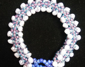 Blue beaded bracelet embellished with fresh water pearls.