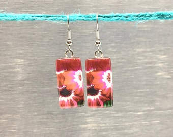 Rectangle earrings: photograph of pink flower gerbera  under a rectangle glass cabochon. Non-allergenic stainless steel hook