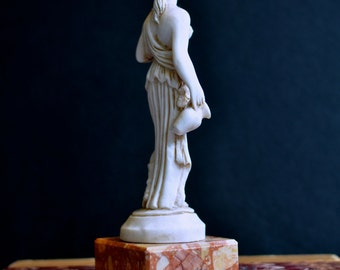 classical Greek maiden figurine with marble base