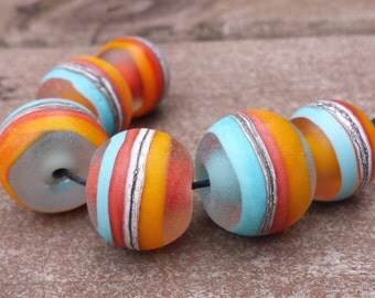 Lampwork Bead set Rounds in warm colours of turquoise, coral, yellow, silvered ivory and clear. All etched for a soft matte finish