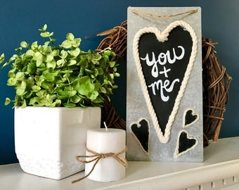 Metal 'You + Me' Sign with Chalkboard Hearts Outlined in Rope