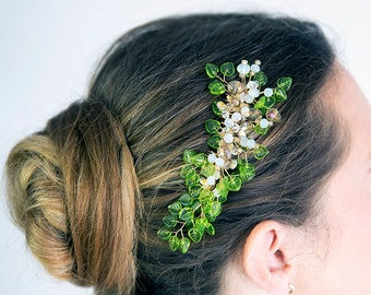 Bridal hair comb. Wedding hair piece. Austrian glass leaf beads, Swarovski crystal, metal flowers. Opal blue accents.Ready to ship.