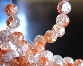 80 approx. orange and clear, 10 mm crackle glass beads, 1.5mm hole