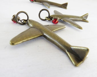 "3 Airplane Charms- Distressed Brass- 2 1/8"" with red gem dangle Antique Look Planes-  Mixed Media, Assemblage. Embellishments"