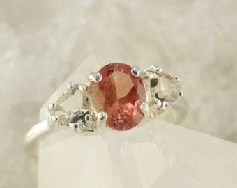 Red Oval Oregon Sunstone Ring with Clear Trillion Oregon Sunstone Accents in Sterling Silver