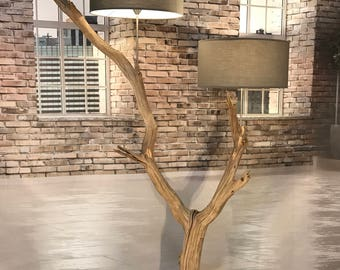 Double floor lamp of old weathered oak branch.