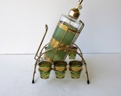 Mid Century Barware - Set of 7 Decanter Set With Carrier - Green Glass with Gold Encrusted Accents -  Hollywood Regency - Vodka Service -